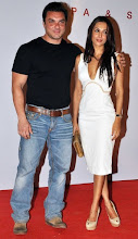 Photo: Indian Bollywood  personalities Sohail Khan (L) and Malika Arora Khan attend the launch of the Kallista Spa and Salon in Mumbai on April 20, 2012. AFP PHOTO/STR (Photo credit should read STRDEL/AFP/Getty Images)