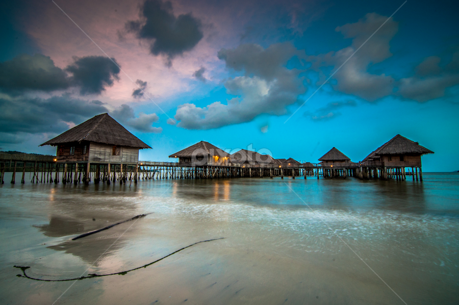 by SooSing Goh - Landscapes Waterscapes ( clouds, stilts, waves, sunset, resort, beach )