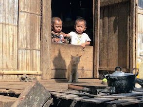 Photo: Lahu twins, cooking pot and the ubiquitous cat