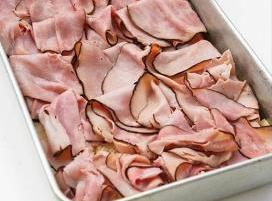Top with sliced ham