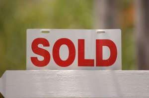 a close up of a sign: Home sellers are showing an increased willingness to list their houses more than a year into the coronavirus pandemic, according to a new survey by realtor.Com.