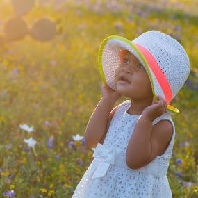 Enjoying Spring Flowers by Larry Crawford - Babies & Children Children Candids ( daytime, outdoor, candid, kids, individuals,  )