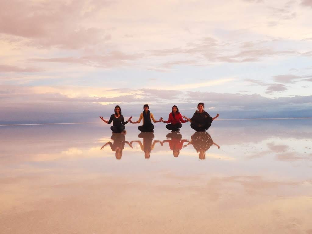 reflective salt flats of bolivia at sunset salar de uyuni pics.jpg