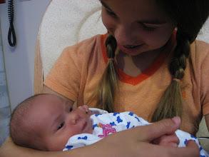 Photo: Rebecca holding Elizabeth.