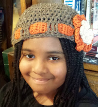 Photo: Crochet hat - Speckled brown & orange, with flower. I made following tutorial at http://www.youtube.com/watch?v=SKyrgiKgMjw.