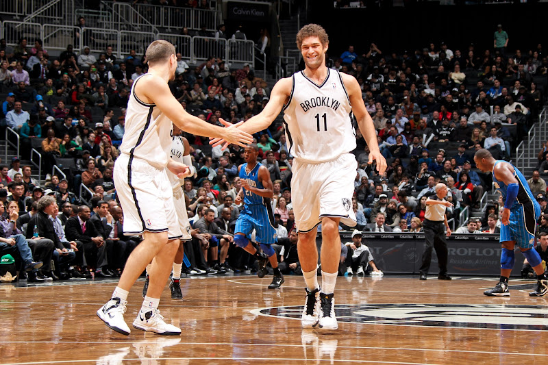 Photo: BROOKLYN, NY - JANUARY 28:  Brook Lopez #11 of the Brooklyn Nets celebrates with teammate Mirza Teletovic #33 during their game against the Orlando Magic on January 28, 2013 at the Barclays Center in the Brooklyn borough of New York City.  NOTE TO USER: User expressly acknowledges and agrees that, by downloading and or using this photograph, User is consenting to the terms and conditions of the Getty Images License Agreement. Mandatory Copyright Notice: Copyright 2013 NBAE  (Photo by Nathaniel S. Butler/NBAE via Getty Images)