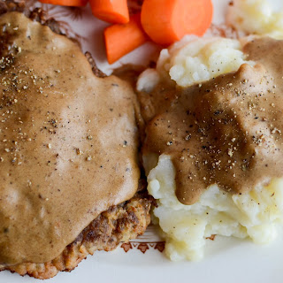 Country Fried Steak with Milk Gravy and Mashed Potatoes.
