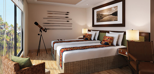 Amazon Discovery Flora Suites feature deluxe beds with fine Peruvian linens.