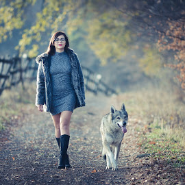 Girl and Wolf by Tinu Coman - People Portraits of Women ( leaves, wolf, road, backlight, autumn, girl, trees, walk, elegant, fashion )