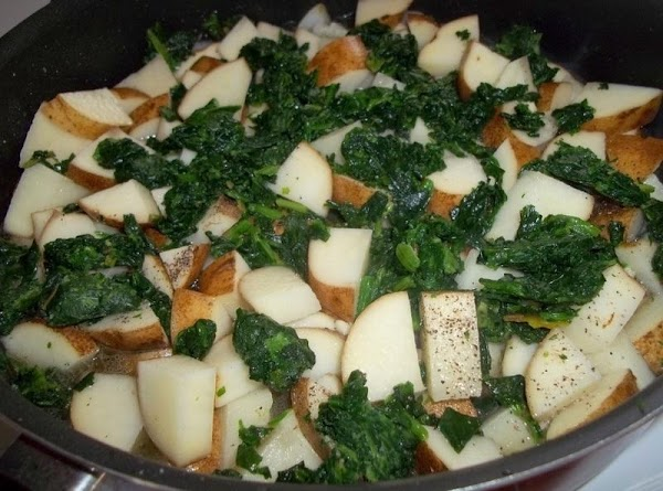 Add potatoes, spinach, salt and pepper and broth. Bring to a boil, then lower...