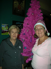 Photo: Trish Holyoak & Delia Lawrie with a very pink Christmas tree!