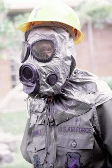 United States Airman wearing an M-17 nuclear, biological, and chemical warfare mask and hood.