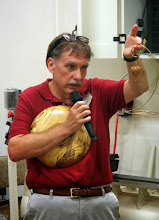 Photo: While he's over there, Tim kicks off the Show & Tell period by showing his hot air balloon Christmas ornament.