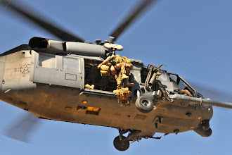 Photo: Pararescuemen hoist Brig. Gen. Jack L. Briggs onto an HH-60G Pave Hawk during a training mission at Bagram Airfield, Afghanistan, Sept. 24, 2010.  The training mission provided a glimpse of what the 33rd ERQS brings to the fight and the capabilities it provides to combat commanders. (U.S. Air Force photo/Staff Sgt. Christopher Boitz)