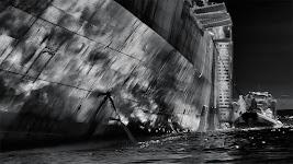 bootje langszij zeeschip