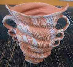 Photo: seven handled double spouted pitcher seen here bisque naked