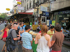 Photo: A growing crowd by a vendor onKhao San Road