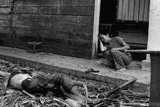 Photo: 12 Apr 1975, Tay Ninh, South Vietnam --- 4/12/1975-Tay Ninh, South Vietnam: A South Vietnamese woman cries over the death of her husband after Communist rockets hit this city some 50 miles northwest of Saigon.  Shelling of Tay Ninh resumed over the past three days after a 15-day pause.  Many families had returned; now they will have to flee again. --- Image by © Bettmann/CORBIS