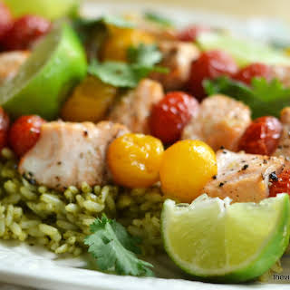 Oven Roasted Salmon and Cherry Tomato Skewers over Mexican Green Rice.