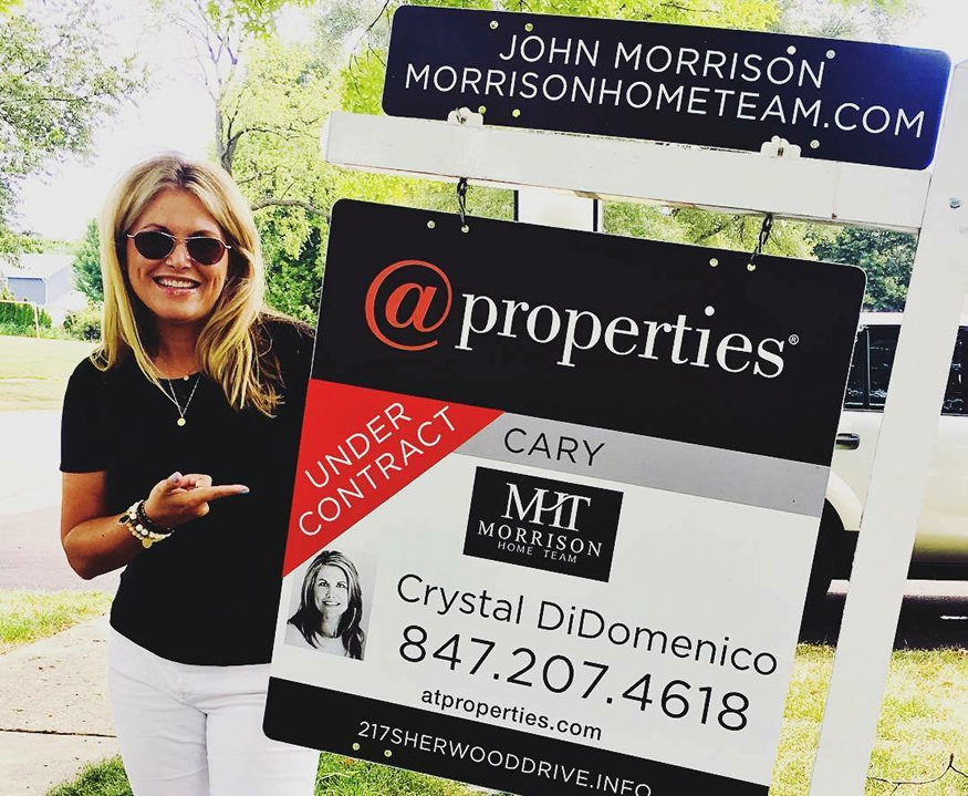 Agent standing next to Under Contract sign
