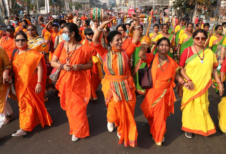 Women attend a protest march against the rise in fuel prices on the occasion of International Women's Day in Kolkata, India, March 8, 2021.
