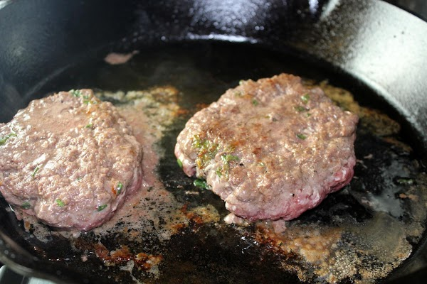 Cook burgers until well done.