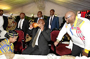 President Cyril Ramaphosa drinks from a gourd from his daughter-in-law Bridget Birungi, while her husband Andile looks on during their traditional wedding ceremony, in this file picture. Ramaphosa has declined to disclose in parliament the amount of money his son received from Bosasa.