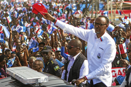 Likely winner: Rwandan President Paul Kagame of the governing Rwandan Patriotic Front waves to his supporters during his final campaign rally in Kigali, Rwanda, on Wednesday. Picture: REUTERS