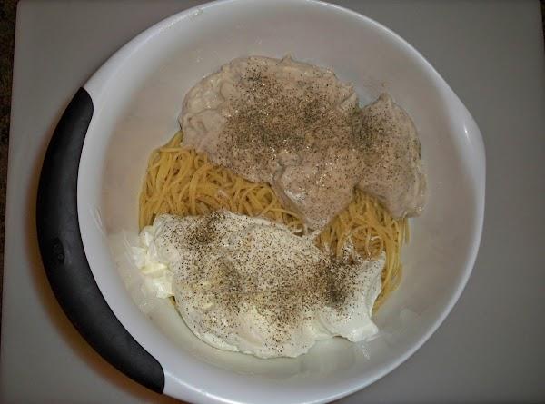 Drain spaghetti and put into a medium sized bowl. Open cream of mushroom soup...