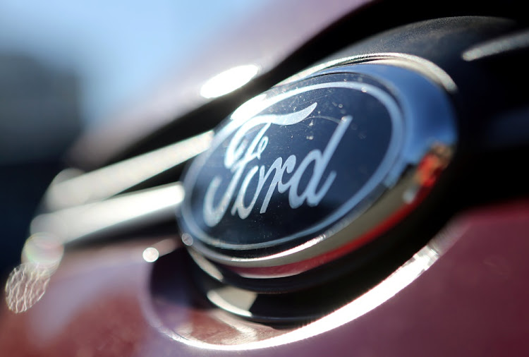 The Ford logo is seen on a car on June 2, 2017.