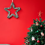 Christmas tree with decorations and a red star topper