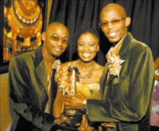 CALLING THEIR OWN TUNE: Malaika: Bongani Nchang, Tshedi Mholo and Jabu Ndaba - with their Best-Selling Album award at the MTN Sama ceremony last weekend. Pic: Eddie Mtsweni. 16/04/05. © ST.