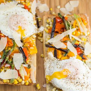 Charred Veggie Ciabatta Pizza with Crispy Fried Eggs + Parmesan.