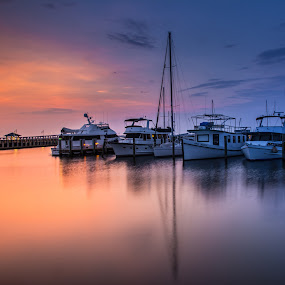 Sun Rise in the Harbor  by David Kreutzer - Transportation Boats ( biloxi, gulfport, harbor, red sky, sun rise, boats, beach, morning, sailboat, boat, mississippi, boating, pier, bay st. louis )