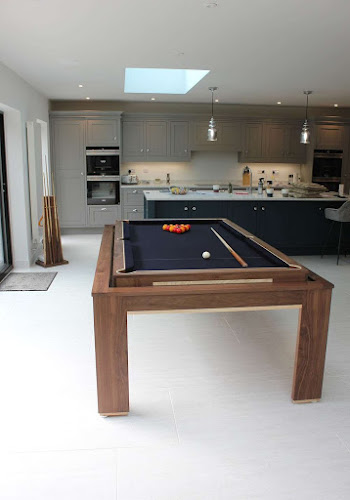 Contemporary kitchen with rotating pool table