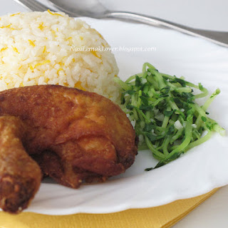 Nasi Ayam Kampung goreng (Deep fried Chicken rice).