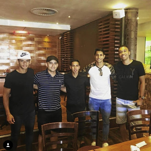 Gustavo Paez, an unnamed friend, and PSL colleagues Gaston Sirino, Leonardo Castro and Ricardo Nascimento out for dinner in Joburg.