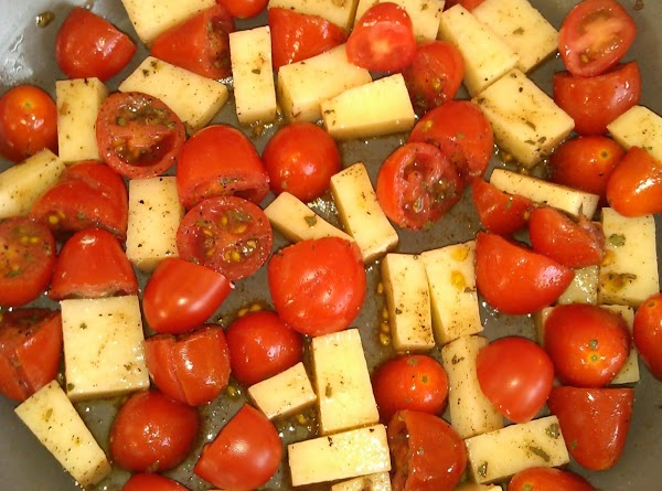 Add olive oil to bottom of baking dish.  Pour in the tomato mixture.