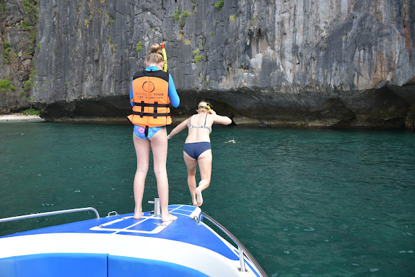 Jump into the turquoise water from the prow of the boat at Maya Bay