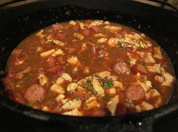 Take off heat. Add stewed tomatoes, water, kitchen bouquet, salt, red pepper, & dried...