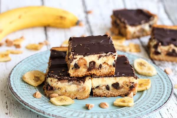 Chocolate Peanut Butter Banana Gooey Bars On A Plate.
