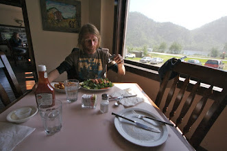 Photo: Chitina town. Tomek is eating his first fish since 15 years.