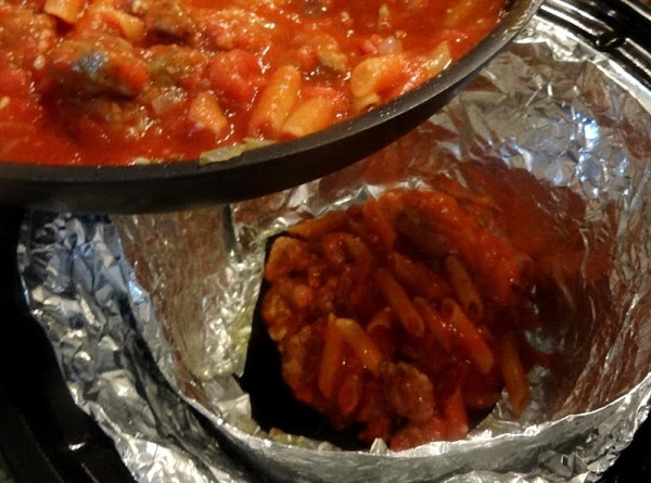 Carefully spoon the sauce into the center of the foil-lined slow cooker.