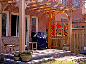 Photo: The homeowner built this arbor AND the stain glass windows. Fern Ridge built the permeable patio.