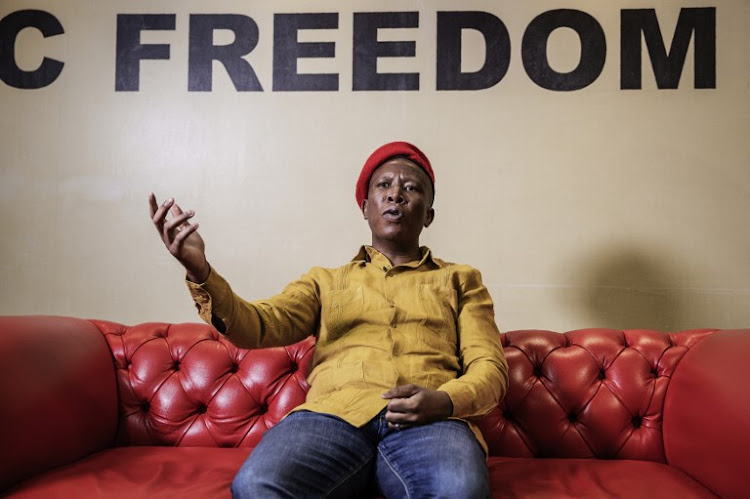 Economic Freedom Fighters opposition party leader Julius Malema talks during an interview with AFP on September 11, 2018 at the party's headquarters in Johannesburg, South Africa.