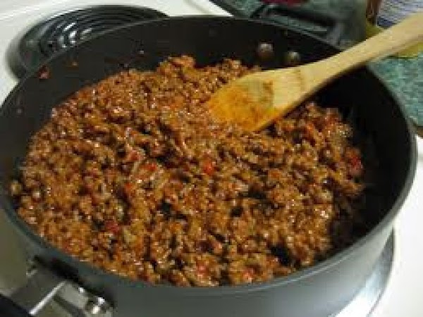 Brown hamburger over a med heat till completely browned, drain and return to pan.