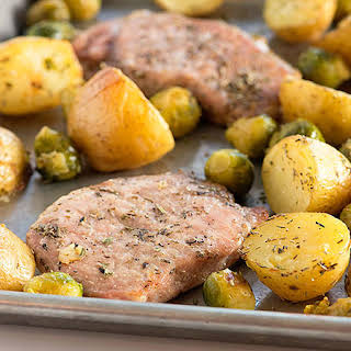 Sheet-Pan Pork Chops with Brussels Sprouts and Potatoes.