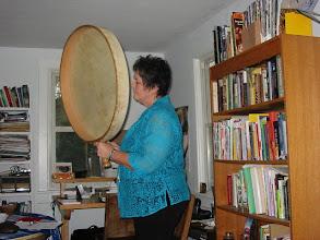 Photo: Carol playing the grandfather drum.
