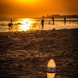 Bottle of Sunshine by Keith Griffiths - Landscapes Sunsets & Sunrises ( southampton, sunset, sea, beach, landscape, bottle, sun,  )