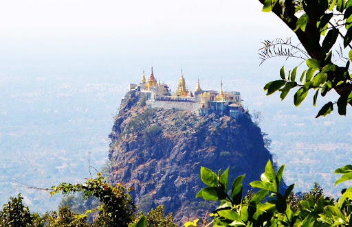 Mt. Popa, a Buddhist monastery, is perched at the summit of Taung Kala in Myanmar. It's a 777-step climb to the top.